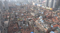 China, old residential neighborhood in Wuhan, 'surrounded' by modern buildings Stock Footage
