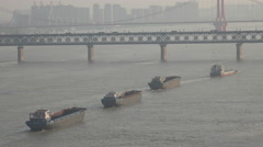Cargo vessels sail upstream at the Yangtze river in Wuhan, China Stock Footage