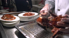 Chief to slice the roast duck barbecued Beijing duck Stock Footage