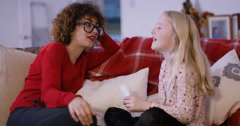 4K Babysitter & little girl relaxing together at home - stock footage