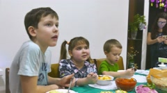 Children eat family breakfast birthday christmas boy and girl eating celebration Stock Footage