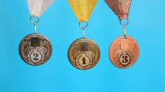 gold, silver, bronze medal on a blue background - stock footage