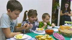 Children eat family breakfast birthday boy and girl christmas eating celebration - stock footage