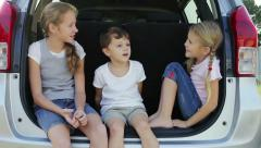 Happy children sitting in car at the day time Stock Footage