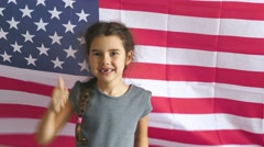 boy teen shows gesture yes Independence Day American usa flag Fourth of July - stock footage