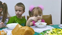 Children eat breakfast  family birthday christmas celebration Stock Footage