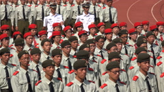 China Communism, students in military uniforms marching at university Stock Footage