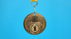 gold medal on a blue - stock footage
