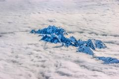 Alps Over the Clouds - stock photo