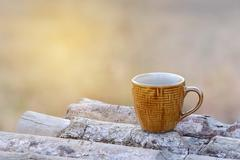 Coffee cup on wooden coaster natural background on the morning. - stock photo