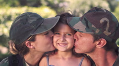 Parents soldier reunited with their daughter Stock Footage