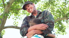 Handsome soldier reunited with his son Stock Footage