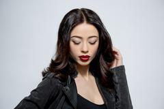Fashion model woman with dark red lips in studio - stock photo