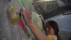 Slow Motion Woman Rock Climbing Reaching For Grip Hold - stock footage