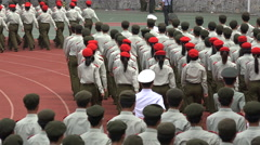 Rows of Chinese college students, military performance, abstract view berets Stock Footage