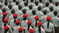 Beautiful pattern of Chinese students wearing army uniform and classic berets Stock Footage