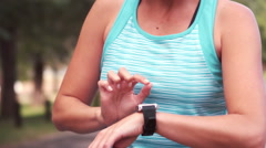 Fit woman setting heart rate watch Stock Footage