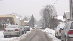 Bad car driving conditions at heavy snow fall in winter. 4K Stock Footage