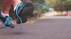 Jogger tying his shoe lace Stock Footage