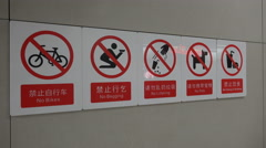 No begging, cycling, littering etc in metro station in China Stock Footage