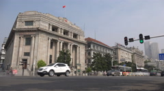 Traffic drives past investment corporation office in colonial building, China - stock footage