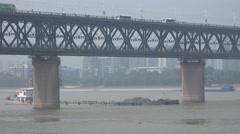 Cargo vessel under Wuhan Yangtze river bridge Stock Footage
