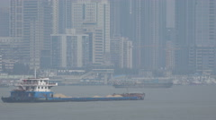 Cargo vessel sails over Yangtze river through Wuhan city in central China Stock Footage