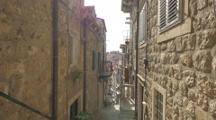 Beautiful view of a narrow street between stone buildings in Dubrovnik Stock Footage