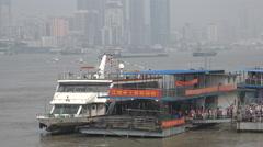 Ferry passengers disembark vessel, Yangtze river crossing in Wuhan, China Stock Footage