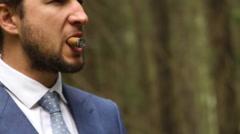 Man in suit smoking cigar Stock Footage
