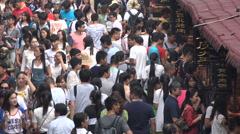 People visit busy popular street food market in central Wuhan city, China - stock footage