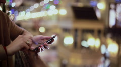 Woman hands texting, using smartphone in mall - stock footage