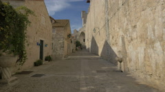 Street between stone buildings and the City Walls in Dubrovnik - stock footage