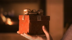 Woman holding red present box in hands - stock footage