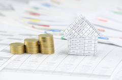 Close up house and step gold coins have blur paperwork - stock photo