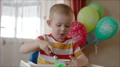 Little Boy Eating Yogurt from the Jar Stock Footage