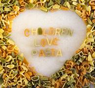 Pasta in a heart shape - stock photo