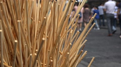 Wooden kebab sticks are collected in garbage cans, street food market in China Stock Footage