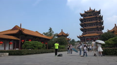 People visit a the Yellow Crane Tower pagoda in Wuhan, China - stock footage
