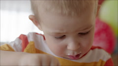 Boy with Dirty Face Having a Bite Stock Footage