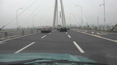 China infrastructure, taxi drives over modern suspension bridge in Wuhan - stock footage