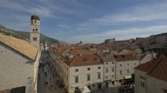 Franciscan church bell tower and crowded Stradum, Dubrovnik Stock Footage