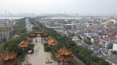 China, overview of the entrance to the Yellow Crane Tower in Wuhan, city skyline - stock footage