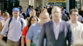 Crowd large group business people commuters walk New York City NYC slow motion Footage