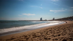 Timelapse of beautiful beach in Barcelona, Spain - stock footage