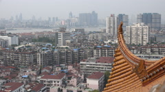 Roof of ancient (rebuilt) Chinese pagoda, Wuhan city skyline Stock Footage
