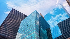 Glass skyscrapers blue sky reflection mirror facades buildings New York City NYC Stock Footage
