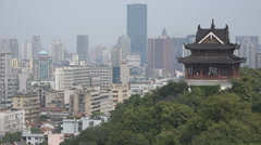 Traditional temple contrasts with modern city skyline in Wuhan, China - stock footage