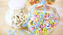 Colorful candy in glass jars of candy sit on the table. Stock Footage