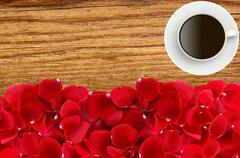 Beautiful red rose petals and coffee cup over wood texture close-up Stock Photos